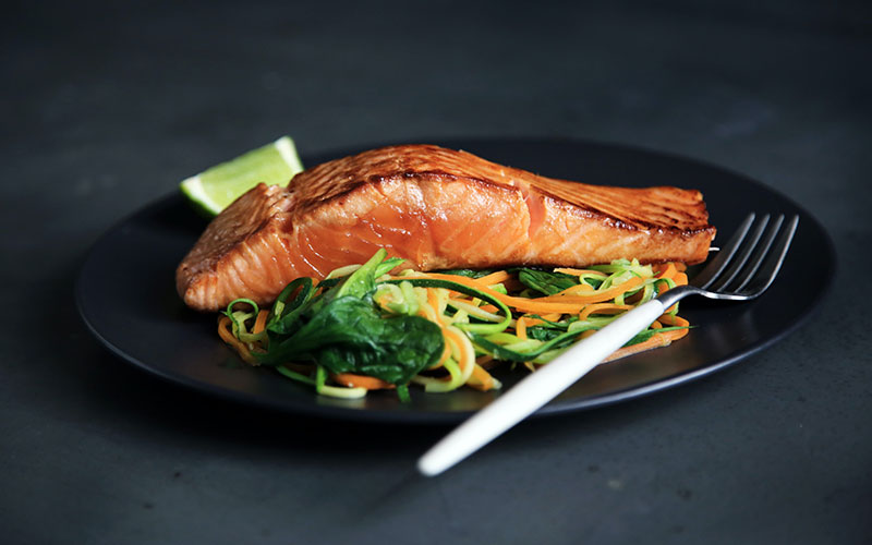 Baked salmon with salad on plate