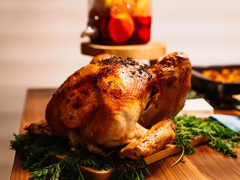 Roasted turkey on cutting board