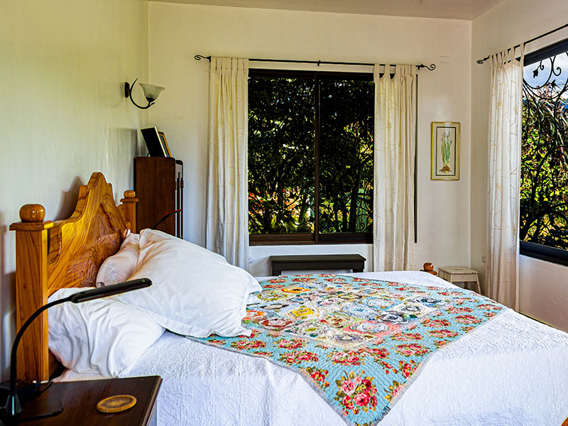 Bed with floral blanket