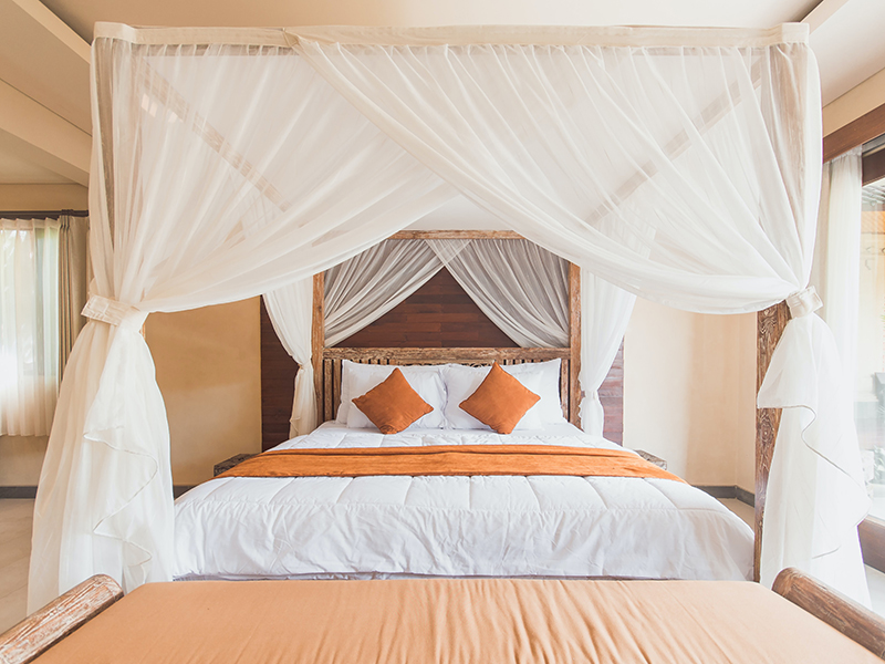 Beautiful bed with orange pillows