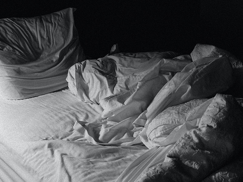 Black and white unmade bed